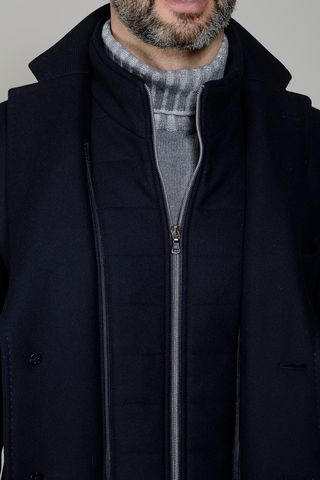 navy twill coat with bib. Angelico