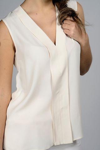 v-neck sleeveless cream top with pleat Angelico