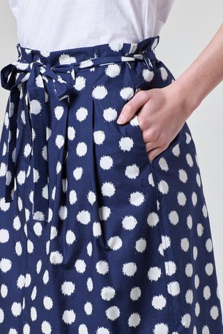 blue pleated skirt with white polka dots Angelico